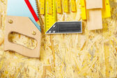 Carpentry tool set on plywood board — Stock Photo