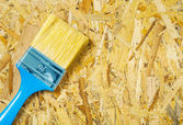 A paintbrush on plywood — Stock Photo