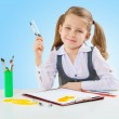 A little girl at shool table — Stock Photo