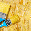 Two brushes on plywood — Stock Photo