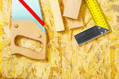Carpenter tools on plywooden board — Stock Photo