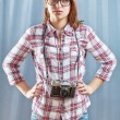 Hipster girl with camera — Stock Photo