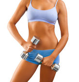 Close up view on female body with dumbbells in hand — Stock Photo
