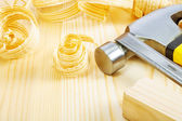 Hammer and chisel on boards — Stock Photo