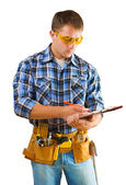 Construction worker writing in paperclip — Stock Photo