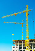 Construction cranes in work — Stock Photo