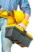 Toolbox in hand of worker — Stock Photo