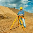 A worker with theodolit — Stock Photo