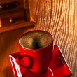 Stock Photo: Cup of cappuchino and coffee grinder on wooden board