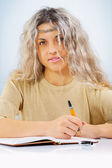 Beautyful young female with ballpoint pen — Stock Photo