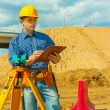 Stock Photo: A contractor writing in clipboard