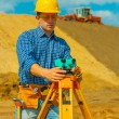 A contractor with theodolite — Stock Photo