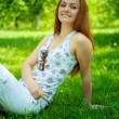 Stock Photo: Brunette on green grass