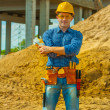 Contractor on building place — Stock Photo