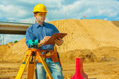 A contractor writing in clipboard — Stock Photo