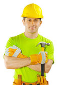 Construction worker holding claw hammer — Stock Photo