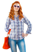 Redhead girl with hand bag isolated — Stock Photo