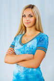 Beautyful blonde on blue background — Stock Photo
