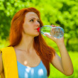 Foto Stock: A female drinking water