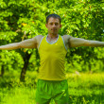 Man do gimnastic in park — Stock Photo
