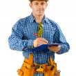 Contractor writing in clipboard — Stock Photo #27608855