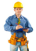 Contractor writing in clipboard — Stock Photo