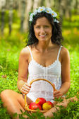 Beautyful female holding basket of apples — Stock Photo