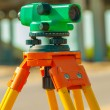 Theodolite on construction place close up — Stock Photo