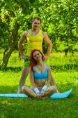 Sports girl and man on nature — Stock Photo