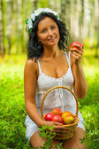 A young female holding apple — Stock Photo