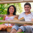 Stock Photo: A couple resting on wooden bridge