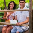 Stock Photo: A couple sitting on wooden bridge