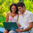 Stock Photo: Couple with laptop in park