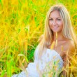 Stock Photo: Beautyful blond sitting in wheat