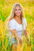 A romantic girl in the field whea — Stock Photo