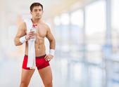 A sportsman with bottle of water — Stock Photo