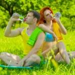 Sports couple on nature — Stock Photo