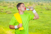 A sportsman drinking water from bottle — Stock Photo