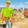 Stock Photo: Builder on work place