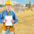 Contractor on road construction with clipboard — Stock Photo #32855769