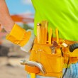 Worker with tools in belt — Stock Photo