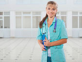 A female doctor with a folder and ballpoint pen — Stock Photo