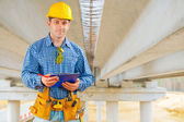 A contractor under the bridge under construction — Stock Photo