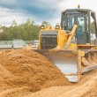 Bulldozer moving sand — Stock Photo