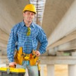 Contractor under the bridge — Stock Photo
