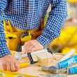 Hands of carpenter do fixes — Stock Photo
