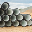 Stock Photo: Stack of ribbed pipes