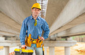 Contractor under the bridge — Foto Stock