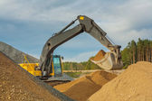 Excavator moving sand — Stock Photo