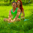 Couple sitting on grass — Stock Photo